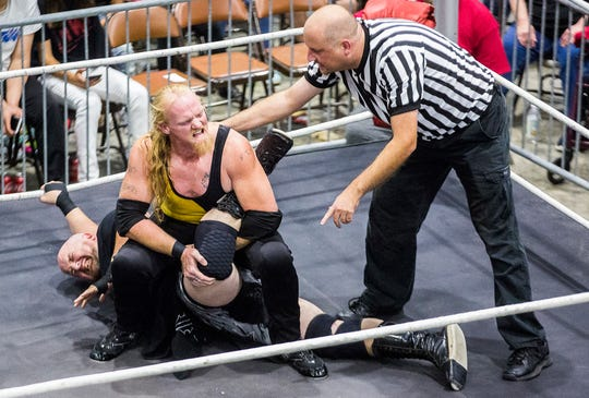 A referee steps in during a match at the Wrestling for Christian show held by Delaware County Championship Wrestling Saturday, Aug. 24, 2019, at Madjax.