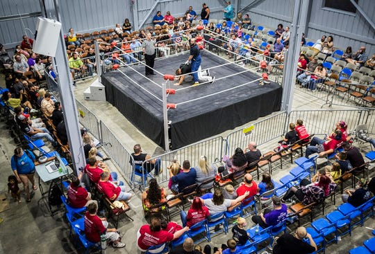 Pro wrestlers face off in the ring at Madjax on Saturday, Aug. 24, to raise funds for medical and funeral costs for Christian Daugherty.