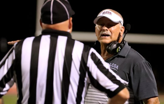 Alcoa's head coach Gary Rankin argues a call with an official during the game against Blackman at Blackman on Saturday Aug. 24, 2019.