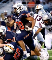 Blackman's Antonio Malone (30) runs the ball during the game against Alcoa at Blackman on Saturday Aug. 24, 2019.