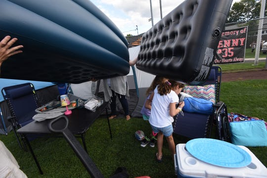 The Emerson Police Dept Community  hosted  its annual free open house/movie night together with a free overnight family camp out for Emerson residents.Tom and Sue Gibbons setting up their quarters for the evening.