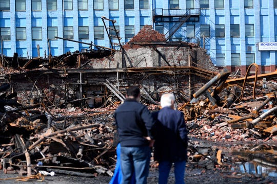 Paterson Mayor Andre Sayegh, left, and Rep. Bill Pascrell, Jr., right, survey the damage after holding a press conference on Sunday, August 25, 2019, in Paterson. A five-alarm fire destroyed the Straight and Narrow counseling center, displacing about 200 people on Saturday, August 24, 2019.