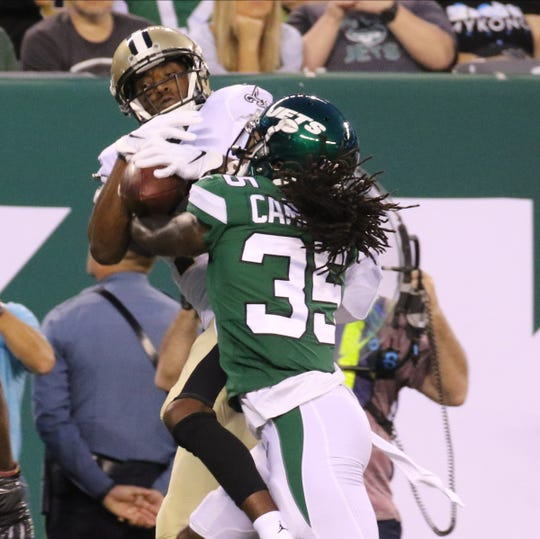 Michael Thomas of the New Orleans Saints makes this touchdown catch over Tevaughn Campbell of the NY Jets during the game between the New Orleans Saints and the New York Jets in a pre season NFL game at Metlife Stadium in East Rutherford, NJ on August 24, 2019.