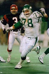 In this Nov. 30, 1987, file photo, Cincinnati Bengals place kicker Jim Breech (3) and New York Jets' Barry Bennett (78) react after Bennett blocked his game winning field goal attempt as they watch Jets' Rich Miano pick up the ball and run 67 yards for the winning touchdown in the fourth quarter of an NFL football game at Giants Stadium in East Rutherford.