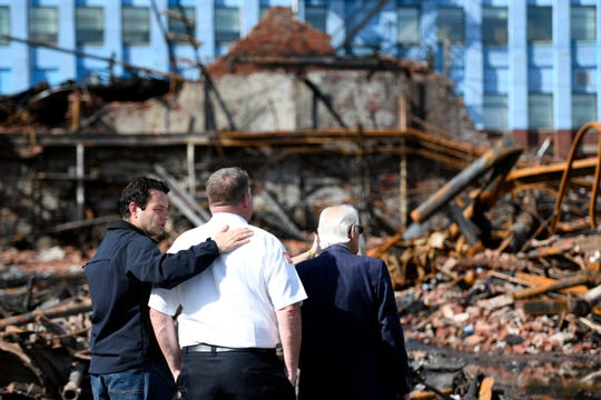 Paterson Mayor Andre Sayegh, Fire Chief Brian McDermott and Rep. Bill Pascrell, Jr., survey the damage on Sunday, Aug. 25, 2019, from a five-alarm fire that destroyed the Straight and Narrow counseling center on Saturday, Aug. 24, 2019.