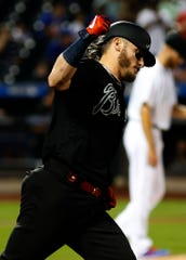 Aug 24, 2019; New York City, NY, USA; Atlanta Braves third baseman Josh Donaldson (20) reacts after hitting a solo home run against the New York Mets during the third inning during an MLB Players' Weekend game at Citi Field.