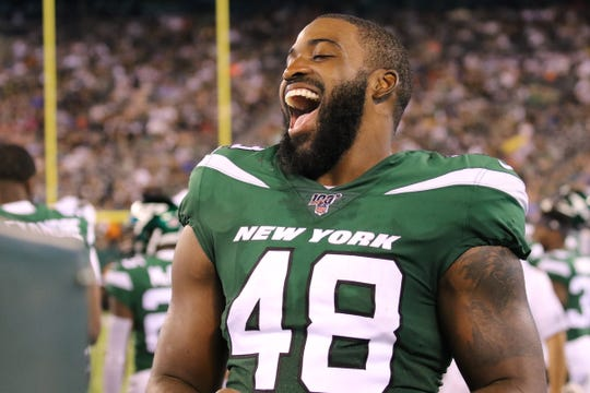 Linebacker, Jordan Jenkins on the Jets sideline during the game between the New Orleans Saints and the New York Jets in a pre season NFL game at Metlife Stadium in East Rutherford, NJ on August 24, 2019.