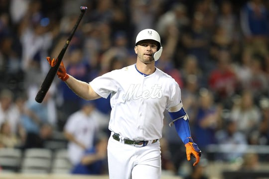 New York Mets' Pete Alonso drops his bat after hitting a three-run home run that ties the Mets' team record for most homers in a season during the fifth inning of a game against the Atlanta Braves, Saturday, Aug. 24, 2019, in New York on MLB Players' Weekend.