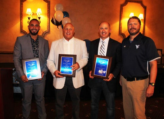 Wayne Valley football Hall of Fame inductees: (from left) Matt Dortch, Cal Koch and Anthony Campana with coach Roger Kotlarz.