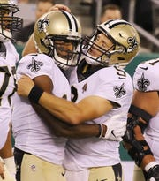 Michael Thomas of the New Orleans Saints celebrates with quarterback Drew Brees after making a touchdown catch  during the game between the New Orleans Saints and the New York Jets in a pre season NFL game at Metlife Stadium in East Rutherford, NJ on August 24, 2019.