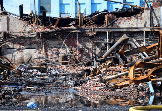 The damage seen on Sunday, August 25, after a five-alarm fire destroyed the Straight and Narrow counseling center, displacing about 200 people on Saturday, August 24, 2019.