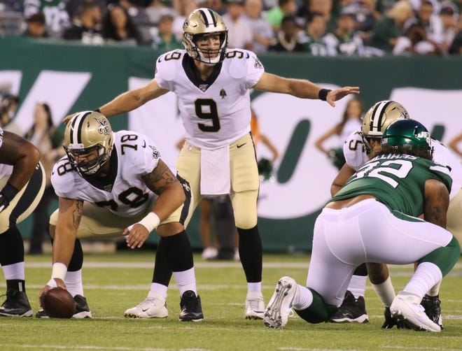 Drew Brees of the New Orleans SaintsÊcalls the play bat the line during the game between the New Orleans Saints and the New York Jets in a pre season NFL game at Metlife Stadium in East Rutherford, NJ on August 24, 2019.