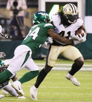 Brian Poole of the NY Jets tackles Alvin Kamara of the New Orleans Saints early in the game between the New Orleans Saints and the New York Jets in a pre season NFL game at Metlife Stadium in East Rutherford, NJ on August 24, 2019.
