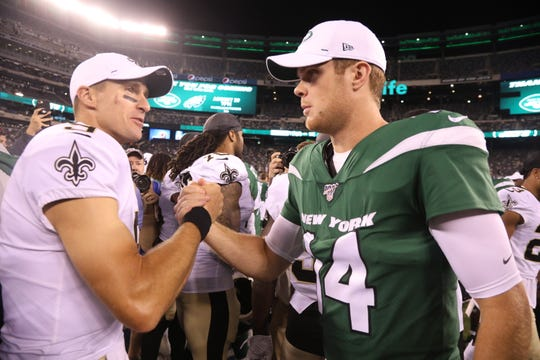 Quarterbacks, Drew BreesÊand Sam Darnold at the end of the game between the New Orleans Saints and the New York Jets in a pre season NFL game at Metlife Stadium in East Rutherford, NJ on August 24, 2019.