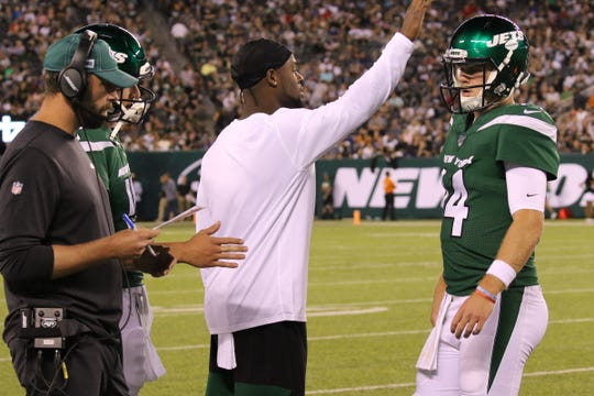 Head coach Adam Gase with Le'Veon Bell asÊSam Darnold of the NY Jets came to the sidelines during a time out in  the game between the New Orleans Saints and the New York Jets in a pre season NFL game at Metlife Stadium in East Rutherford, NJ on August 24, 2019.