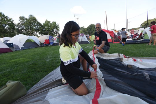 The Emerson Police Dept Community  hosted  its annual free open house/movie night together with a free overnight family camp out for Emerson residents.8-year-old Mia and her father, Nestor Gonzales setting up the tent.