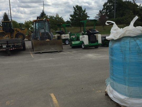 Transitioning from grass to turf required some heavy equipment.