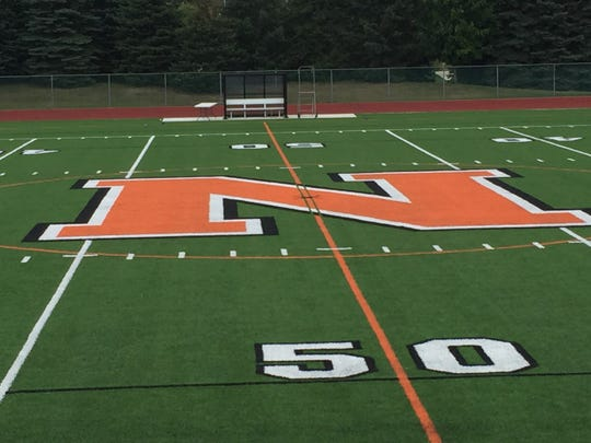 The surface of Northville High School's onsite competition field transitioned from real grass to field turf over the summer.