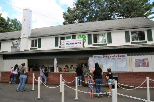 People line up early Sunday morning on Aug. 25, 2019 to get their 4-H milkshake as part of the Dutchess County Fair's final day.