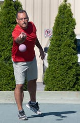 Byron Le Cates, who have been playing on Victor's court for eight years, throws out a ball during a Bocce Ball tournament at Victor's Italian Restaurant in Spring Garden Township.