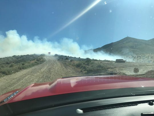 Smoke from a fire burning on the northeast side of Peavine Mountain on Sunday, Aug. 25.