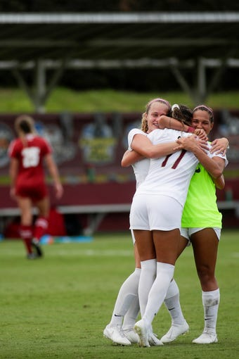 Florida State Seminoles midfielder/defender Heather Payne (12) and Florida State Seminoles Deyna Castellanos (10) hug Florida State Seminoles Malia Berkely (17) after Berkely scored the game-winning goal to defeat the University of Wisconsin Badgers 1-0 in overtime at the Seminole Soccer Complex Sunday, August 25, 2019.