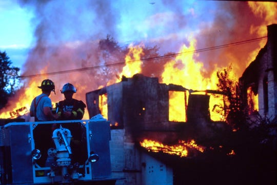 Peekskill firefighters with help from several neighboring departments battle a fire at the former Mill Printing Corporation on Ringold Street in Peekskill on June 24, 1991.