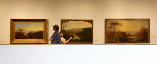 Sunday, Aug. 25, 2019: Daniel Schearer of Larchmont and his son Ian, 11, take in the Hudson River School paintings on display at the Hudson River Museum. Weekends at the museum offer a variety of options for visitors including art and science workshops for families, planetarium shows, and tours of  the Glenview historic home.