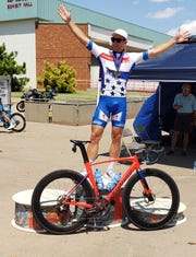 Chris Tolley poses in front of the MPEC after winning the Hotter'N Hell men's pro overall omnium title Sunday.