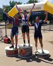 Rebecca Larson (center) is joined by Monica Merced (left) and Michelle Montoya on the podium in front of MPEC as the top three finishers in the Hotter'N Hell women's pro criterium Sunday.