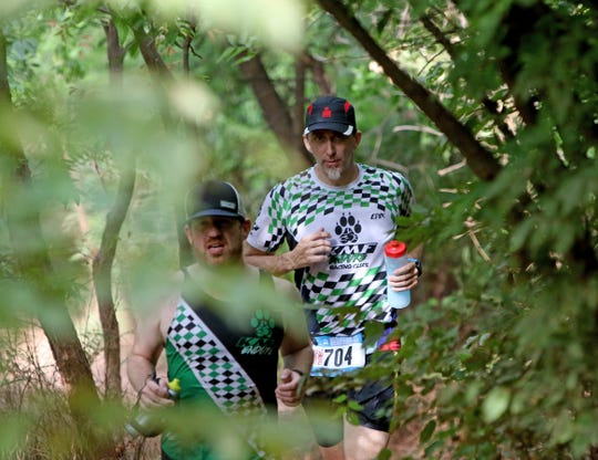 Runners take part in an off-road trail run on the Wee-Chi-Tah Trail Saturday, Aug. 25, 2019, on the final day of the Hotter'N Hell Hundred near the J.S. Bridwell Ag Center.