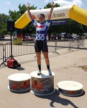 Rebecca Larson poses in front of the MPEC after winning the overall omnium title in the women's pro division at Hotter'N Hell on Sunday.