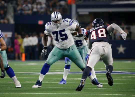 Dallas Cowboys offensive tackle Cameron Fleming (75) defends against a rush by Houston Texans linebacker Davin Bellamy (48) in the first half of a preseason NFL football game in Arlington, Texas, Saturday, Aug. 24, 2019. (AP Photo/Michael Ainsworth)
