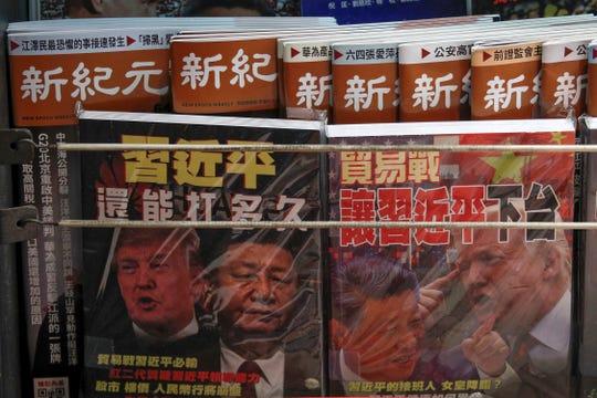 Chinese magazines highlighting the US-China trade war at a stand in Hong Kong on July 4, 2019.