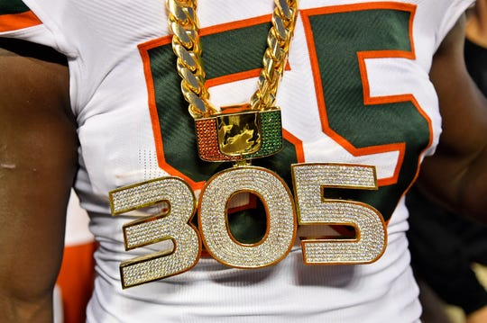 A detailed view of the new Miami Hurricanes' turnover chain worn by linebacker Shaquille Quarterman.