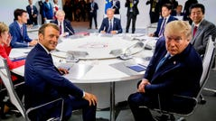 "French President Emmanuel Macron and President Donald Trump attend a working session on ""International Economy and Trade, and International Security Agenda"" on the second day of the annual G7 summit in Biarritz, France."