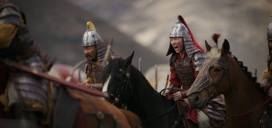"""Mulan (Yifei Liu) rides into battle in """"Mulan"""""""