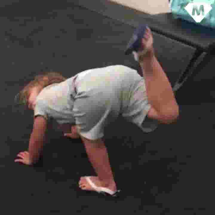 Little girl tries to practice her yoga as she waits for her flight