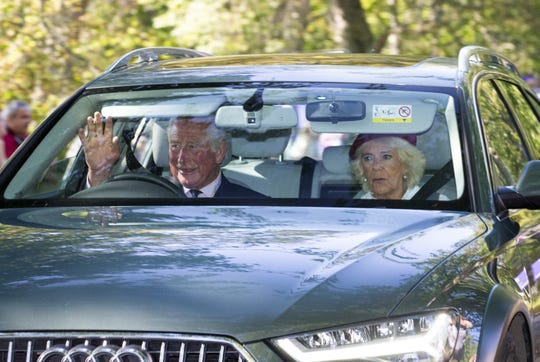 Prince Charles, Prince of Wales, and Camilla, Duchess of Cornwall, drive to Crathie Kirk Church before the service on Aug. 25.