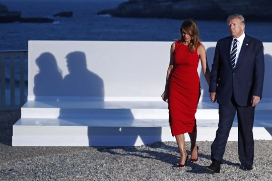 President Donald Trump and Melania Trump walk after posing for the family photo during the G7 summit at Casino in Biarritz, France. The G7 Summit runs from Aug. 24- 26.
