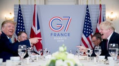 President Donald Trump and Britain's Prime Minister Boris Johnson attend a working breakfast at the Hotel du Palais on the sidelines of the G-7 summit in Biarritz, France.