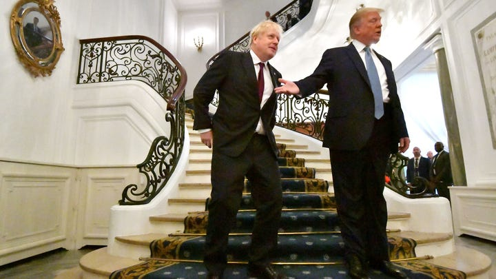 President Donald Trump and Britain's Prime Minister Boris Johnson arrive for a bilateral meeting during the G7 summit  in Biarritz, France.