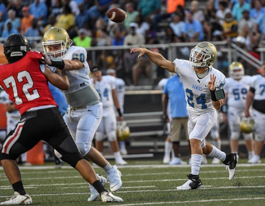 DW Daniel senior Tyler Venables(24) passes during the first quarter at Liberty High School in Liberty Friday, August 23, 2019.