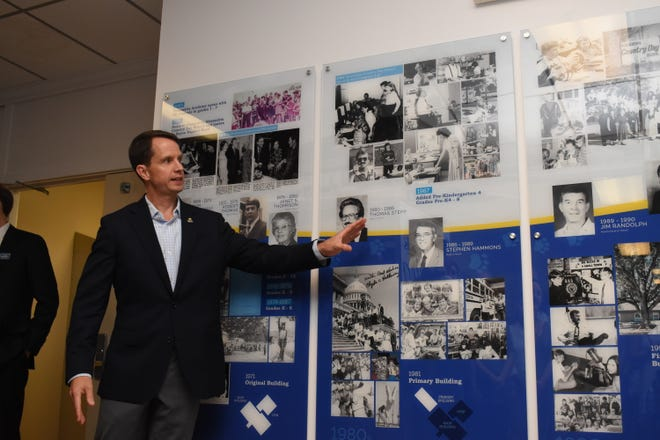 Jonathan Peyton talks about the timeline unveiled at Alexandria Country Day School Monday, Aug. 26, 2019 for the school's 50th anniversary.