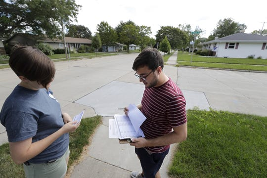 Emma Reading, left, and Tom Lee, both of Appleton, collaborate to canvas a southside neighborhood as part of a 2020 election grassroots plan for the Democratic Party of Outagamie County on Aug. 24 in Appleton.