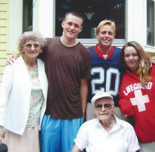 In 2008, around the 20th anniversary of his heart transplant, Kenneth Harmer (center, blue jersey) is pictured with son Kenneth, daughter Victoria and his parents.