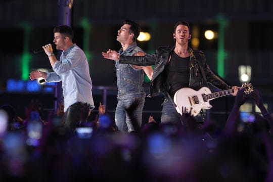 The Jonas Brothers perform Sunday night, August 25, 2019, on the boardwalk across Ocean Avenue from the Stone Pony in Asbury Park.