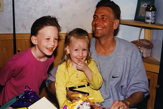 """Kenneth Harmer, right, celebrating a birthday with son Kenneth """"Mike"""" Harmer (left) and daughter Victoria Harmer (center)."""