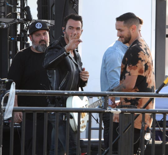 The Jonas Brothers perform Sunday night, August 25, 2019, on the boardwalk across Ocean Avenue from the Stone Pony in Asbury Park, NJ.  They are filming their appearance on the MTV VMAs the following day.
