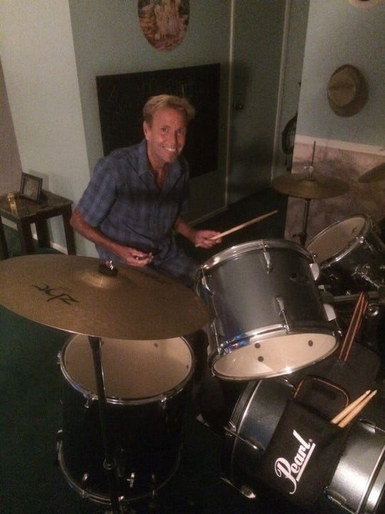 Kenneth Harmer playing the drums years after his heart transplant.
